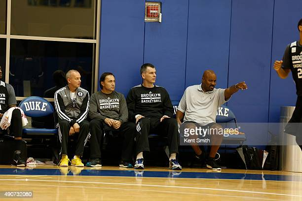 Owner Mikhail Prokhorov and General Manager Billy King of the Brooklyn Nets watches practice during preseason training camp at Duke University on...