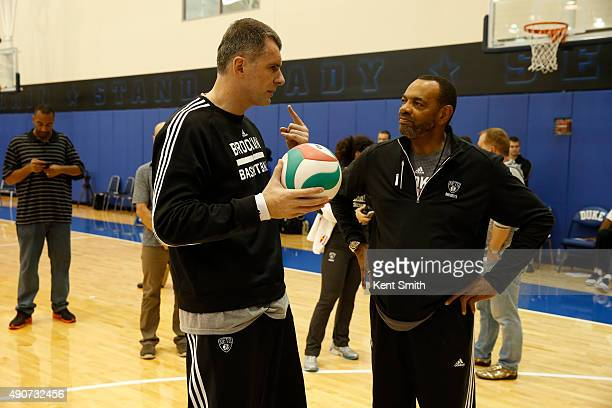 Owner Mikhail Prokhorov and Head Coach Lionel Hollins of the Brooklyn Nets chats during preseason training camp at Duke University on September 30...