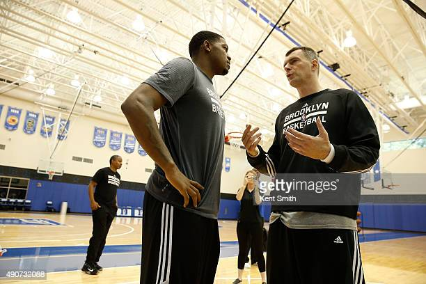 Owner Mikhail Prokhorov and Joe Johnson of the Brooklyn Nets chats during preseason training camp at Duke University on September 30 2015 in Durham...
