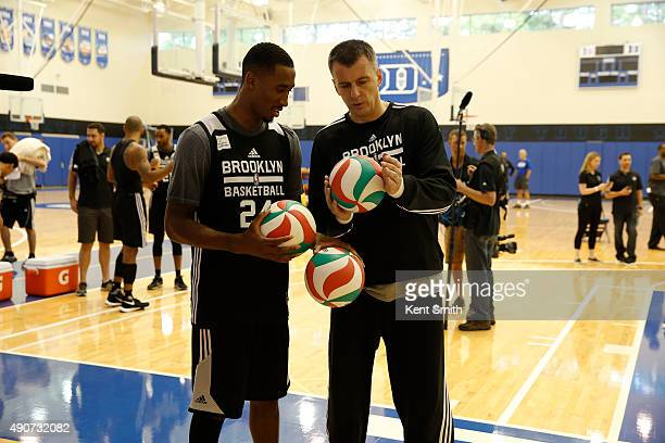 Owner Mikhail Prokhorov and Rondae HollisJefferson of the Brooklyn Nets goes over some drills during preseason training camp at Duke University on...