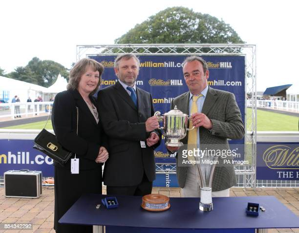 Owner Mr Charle Wentworth is presented with a trophy after his horse Levitate won the William Hill iPhone iPad iPad Mini Ayrshire Handicap stakes