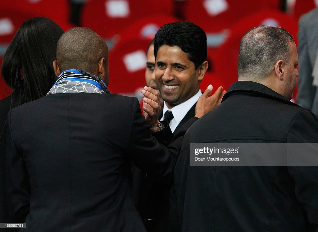 PSG owner Nasser Al-Khelaifi celebrates after the Ligue 1 match between Paris Saint-Germain FC and Stade Rennais FC at Parc des Princes on May 7, 2014 in Paris, France. PSG lost the match 1-2 but still won the 2014 Ligue 1 Champions title.