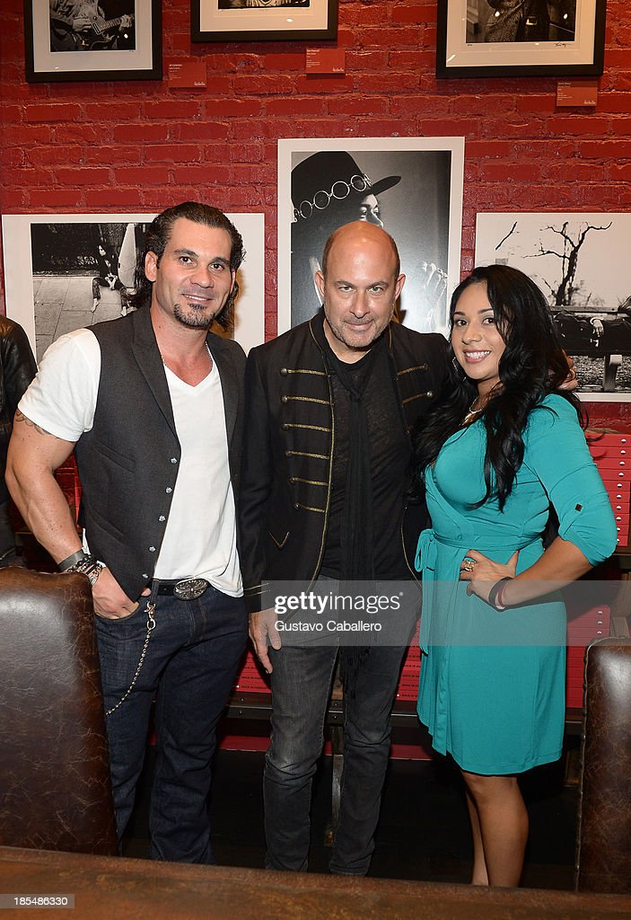 Owner of Adore Miami Nightclub Cory McCormack, John Varvatos and Melinda Filstrup from Adore Miami Nightclub attend the Rock in Fashion Book Launch at John Varvatos South Beach Miami on October 19, 2013 in Miami, Florida..