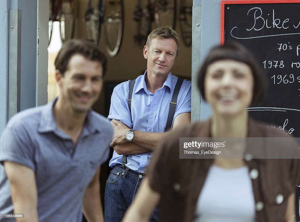 Owner of an Antique Bicycle Store : Stock Photo