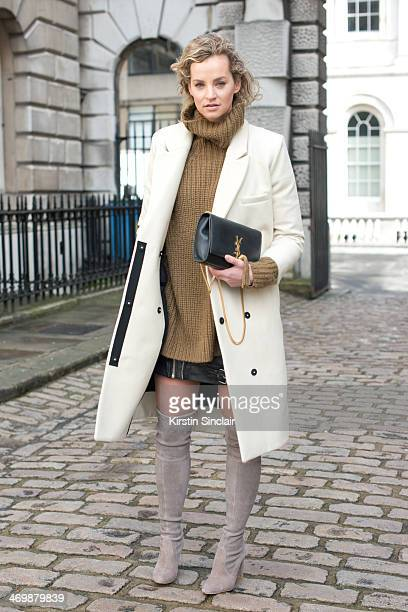 Owner of creator of desire Anouk Bos wears a YSL bag Alls Saints skirt Stuart Weitzman boots and a Carin Wester Coat and sweater on day 2 of London...
