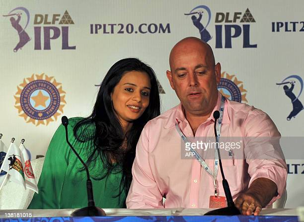 Owner of Deccan Chargers Gayathri Reddy converses with team coach Darryl Lehman during a press conference at the players' auction for the fifth...