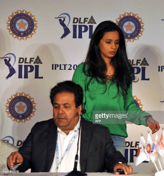 Owner of Deccan Chargers Gayathri Reddy walks past while IPL chairman Rajiv Shukla during a press conference for the players' auction for the fifth...