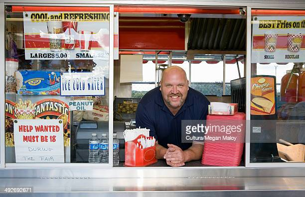Owner of food stall at county fayre, smiling