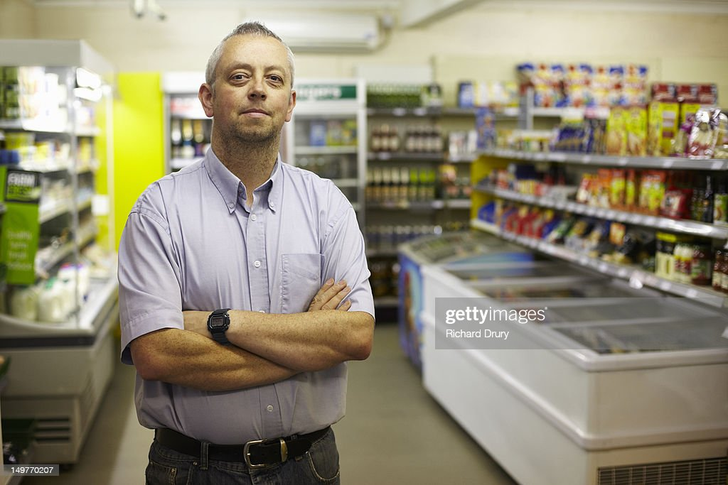 Owner of general stores in his shop : Stock Photo