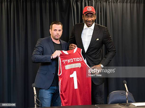 Owner of Hapoel Jerusalem Ori Allon and Amar'e Stoudemire pose at a press conference to announce Amar'e Stoudemire's retirement from the NBA and for...