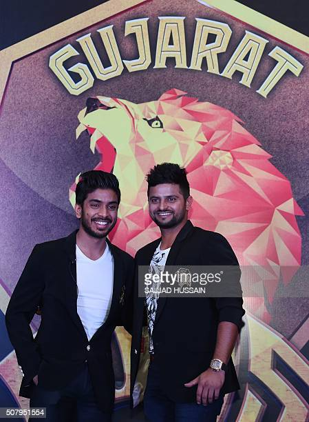 Owner of Indian Premier League's Rajkot team and director of Intex Technologies Keshav Bansal along with Suresh Raina poses for photographers after a...