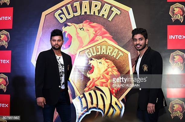 Owner of Indian Premier League's Rajkot team and director of Intex Technologies Keshav Bansal along with cricketer Suresh Raina unveils the logo of...