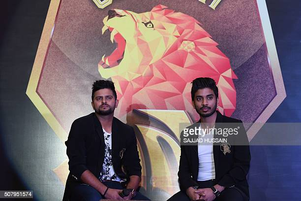 Owner of Indian Premier League's Rajkot team and director of Intex Technologies Keshav Bansal along with cricketer Suresh Raina attend a press...