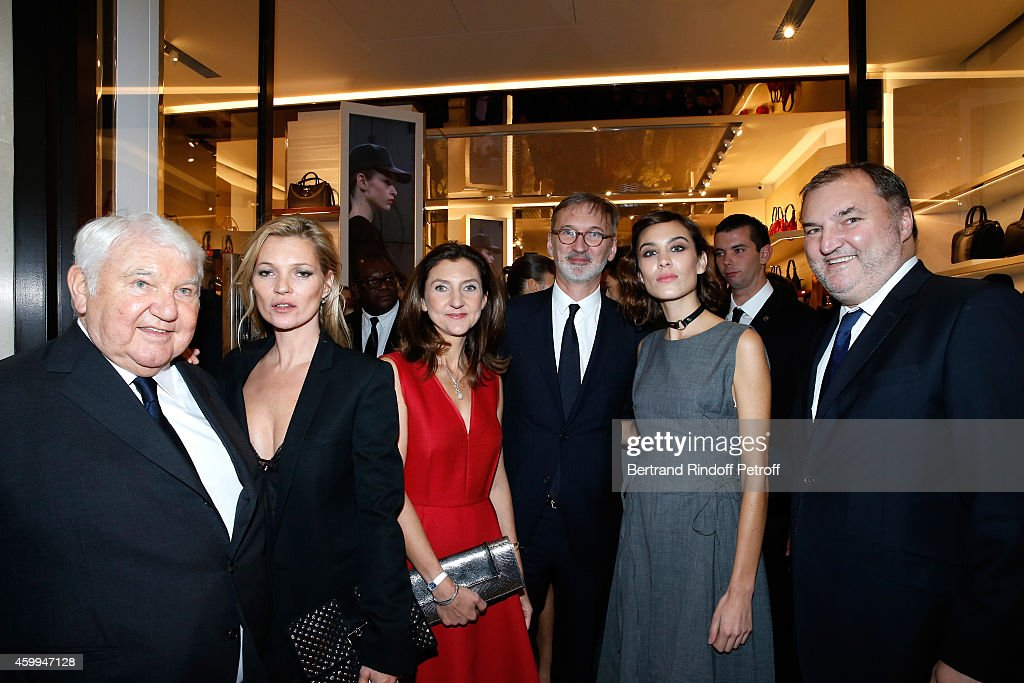 Owner of Longchamp Philippe Cassegrain, Model Kate Moss, Arts Director of Longchamp Sophie Delafontaine, General Director of Longchamp Jean Cassegrain,TV host Alexa Chung and US Head of Retail Olivier Cassegrain attend the Longchamp Elysees 'Lights On Party' Boutique Launch on December 4, 2014 in Paris, France.
