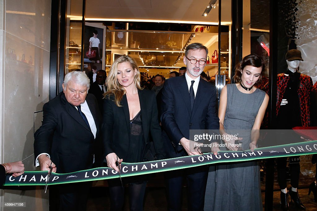 Owner of Longchamp Philippe Cassegrain, Model Kate Moss, General Director of Longchamp Jean Cassegrain and TV host Alexa Chung attend the Longchamp Elysees 'Lights On Party' Boutique Launch on December 4, 2014 in Paris, France.