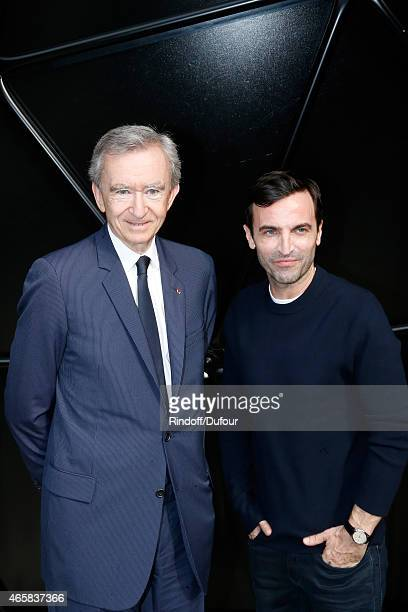 Owner of LVMH Luxury Group Bernard Arnault and Fashion Designer Nicolas Ghesquiere pose after the Louis Vuitton show as part of the Paris Fashion...