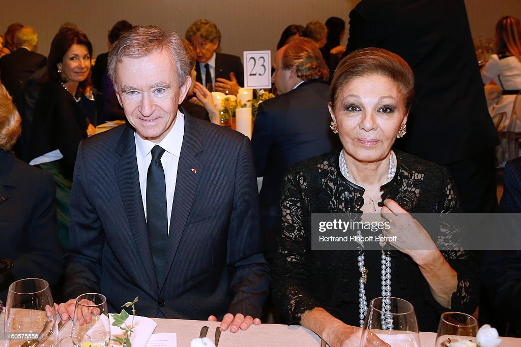 Owner of LVMH Luxury Group Bernard Arnault and HIH Empress Farah Pahlavi attend the 'Fondation Claude Pompidou' : Charity Party at Fondation Louis Vuitton on December 16, 2014 in Paris, France.