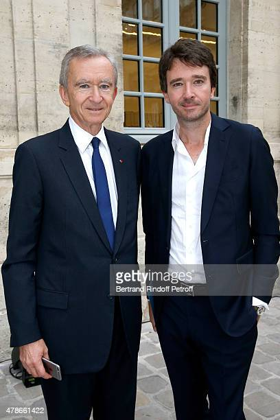 Owner of LVMH Luxury Group Bernard Arnault and his son General manager of Berluti Antoine Arnault attend the Berluti Menswear Spring/Summer 2016 show...