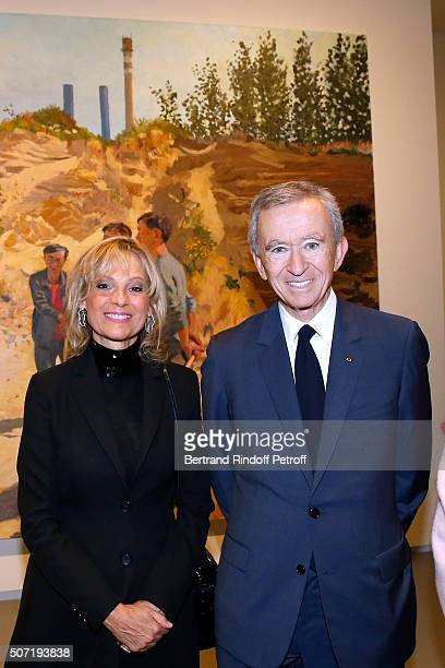 Owner of LVMH Luxury Group Bernard Arnault and his wife Helene Arnault attend the 'Bentu' Exhibition at the Louis Vuitton Foundation Coorganized with...