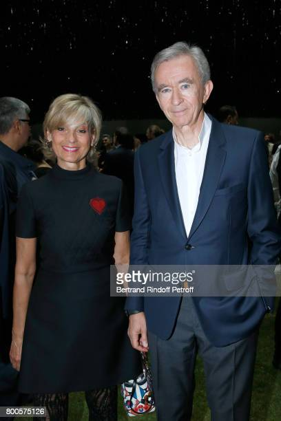 Owner of LVMH Luxury Group Bernard Arnault and his wife Helene MercierArnault attend the Dior Homme Menswear Spring/Summer 2018 show as part of Paris...