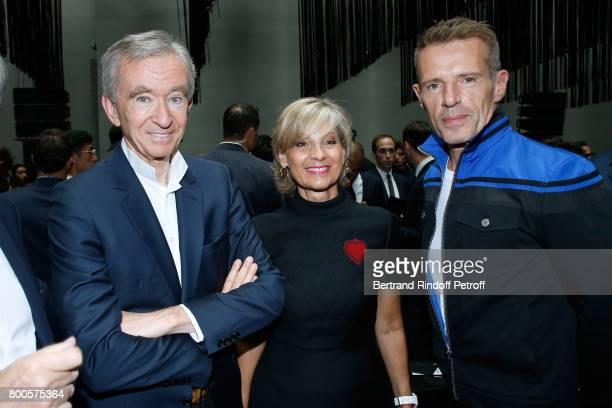 Owner of LVMH Luxury Group Bernard Arnault his wife Helene MercierArnault and actor Lambert Wilson attend the Dior Homme Menswear Spring/Summer 2018...