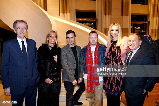 Owner of LVMH Luxury Group Bernard Arnault his wife Helene Arnault Fashion Designer of Louis Vuitton Nicolas Ghesquiere Fashion Designer of Louis...