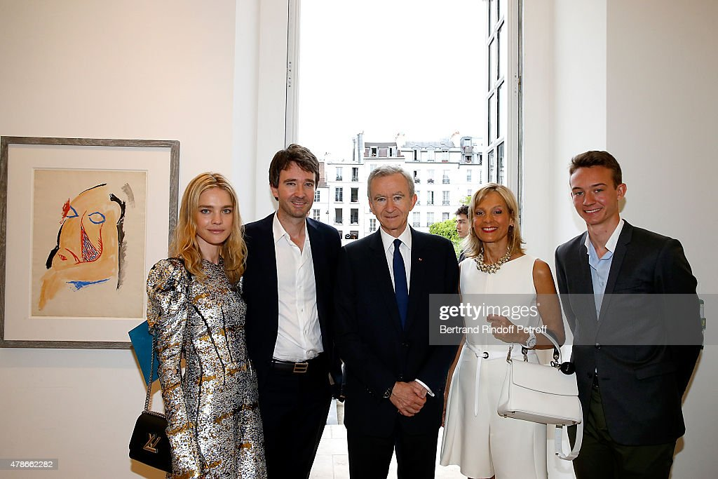 Owner of LVMH Luxury Group <a gi-track='captionPersonalityLinkClicked' href=/galleries/search?phrase=Bernard+Arnault&family=editorial&specificpeople=214118 ng-click='$event.stopPropagation()'>Bernard Arnault</a> (C), his wife Helene Arnault (2nd R), his son General manager of Berluti <a gi-track='captionPersonalityLinkClicked' href=/galleries/search?phrase=Antoine+Arnault&family=editorial&specificpeople=676045 ng-click='$event.stopPropagation()'>Antoine Arnault</a> (2nd L), Model <a gi-track='captionPersonalityLinkClicked' href=/galleries/search?phrase=Natalia+Vodianova&family=editorial&specificpeople=203265 ng-click='$event.stopPropagation()'>Natalia Vodianova</a> (L) and his son Frederic Arnault (R) attend the Berluti Menswear Spring/Summer 2016 show as part of Paris Fashion Week. Held at Musee Picasso on June 26, 2015 in Paris, France.