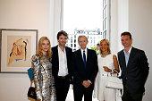 Owner of LVMH Luxury Group Bernard Arnault his wife Helene Arnault his son General manager of Berluti Antoine Arnault Model Natalia Vodianova and his...