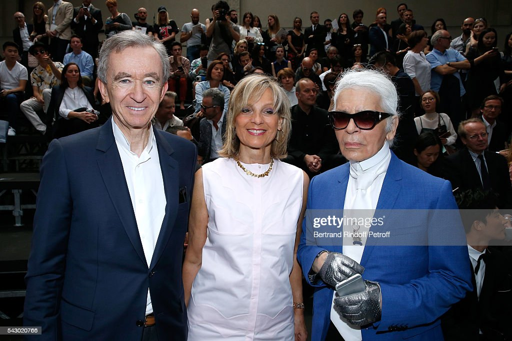 Owner of LVMH Luxury Group Bernard Arnault, his wife Helene Arnault and Karl Lagerfeld attend the Dior Homme Menswear Spring/Summer 2017 show as part of Paris Fashion Week on June 25, 2016 in Paris, France.