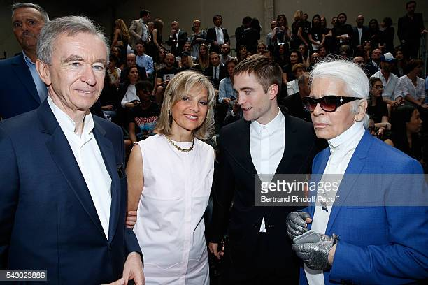 Owner of LVMH Luxury Group Bernard Arnault his wife Helene Arnault Robert Pattinson and Karl Lagerfeld attend the Dior Homme Menswear Spring/Summer...