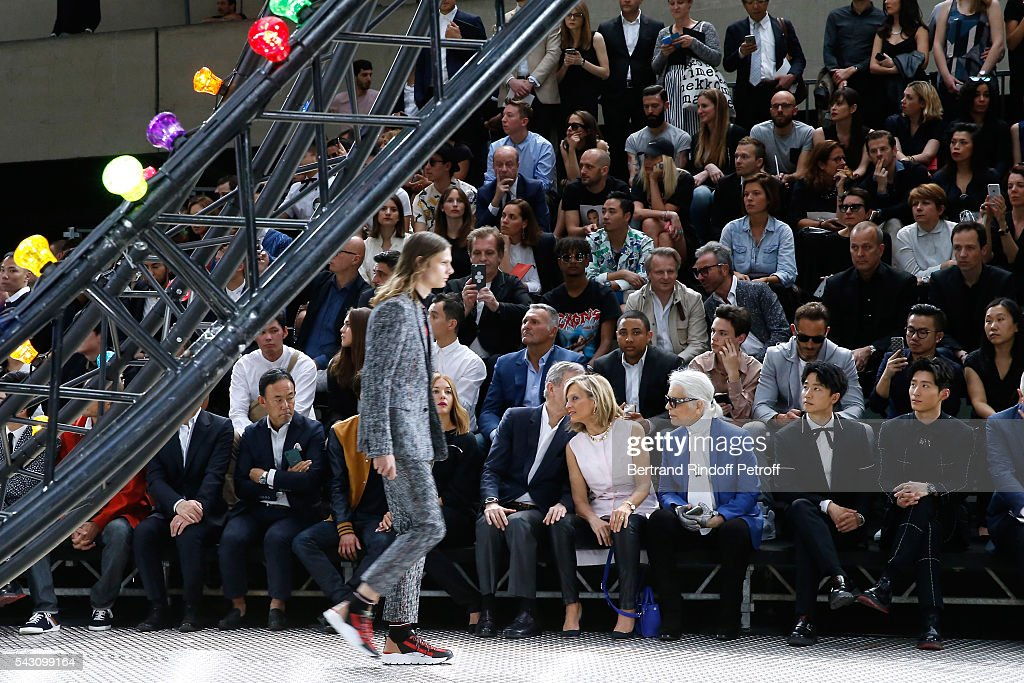 Owner of LVMH Luxury Group <a gi-track='captionPersonalityLinkClicked' href=/galleries/search?phrase=Bernard+Arnault&family=editorial&specificpeople=214118 ng-click='$event.stopPropagation()'>Bernard Arnault</a>, his wife <a gi-track='captionPersonalityLinkClicked' href=/galleries/search?phrase=Helene+Arnault&family=editorial&specificpeople=718530 ng-click='$event.stopPropagation()'>Helene Arnault</a>, Karl Lagerfeld, Xuan Huang and Xiao Dou attend the Dior Homme Menswear Spring/Summer 2017 show as part of Paris Fashion Week on June 25, 2016 in Paris, France.
