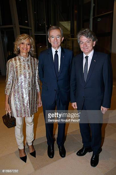Owner of LVMH Luxury Group Bernard Arnault standing between his wife Helene and politician Thierry Breton attend the 'Icones de l'Art Moderne La...