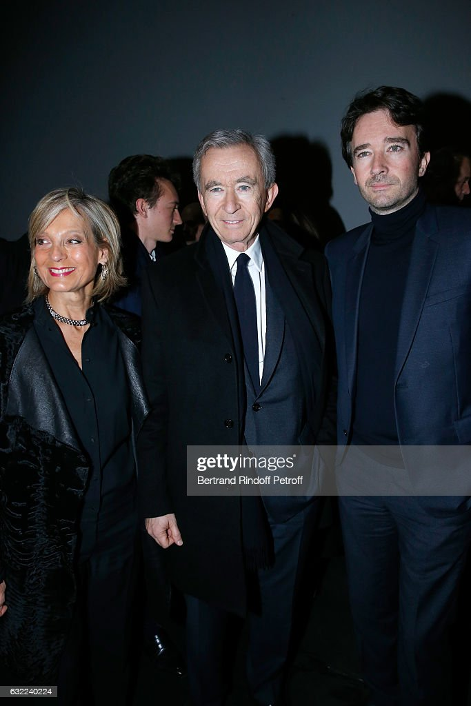 Owner of LVMH Luxury Group Bernard Arnault standing between his wife Helene Arnault and their son General manager of Berluti Antoine Arnault attend the Berluti Menswear Fall/Winter 2017-2018 show as part of Paris Fashion Week on January 20, 2017 in Paris, France.
