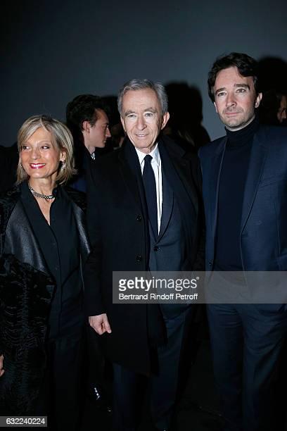 Owner of LVMH Luxury Group Bernard Arnault standing between his wife Helene Arnault and their son General manager of Berluti Antoine Arnault attend...