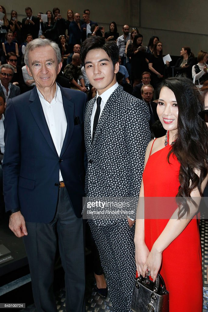 Owner of LVMH Luxury Group <a gi-track='captionPersonalityLinkClicked' href=/galleries/search?phrase=Bernard+Arnault&family=editorial&specificpeople=214118 ng-click='$event.stopPropagation()'>Bernard Arnault</a>, Thailand Celebrity Grit Jirakiertivadhana and Tao Tao attend the Dior Homme Menswear Spring/Summer 2017 show as part of Paris Fashion Week on June 25, 2016 in Paris, France.