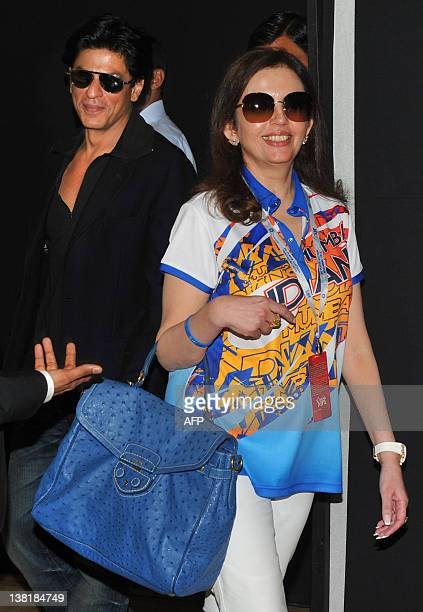 Owner of Mumbai Indians Neeta Ambani and Bollywood actor and owner of Kolkata Knight Riders Shah Rukh Khan arrive arrive for a postplayers' auction...