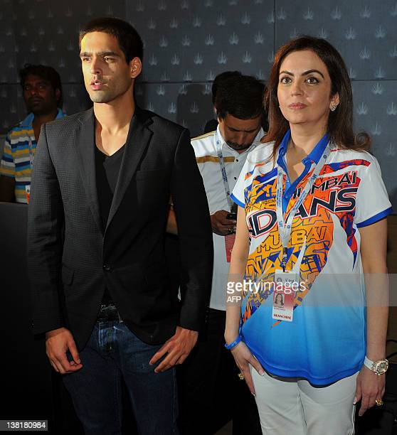 Owner of Mumbai Indians Neeta Ambani and owner of Royal Challengers Bangalore Siddarth Mallya wait for a press conference ahead of the players'...
