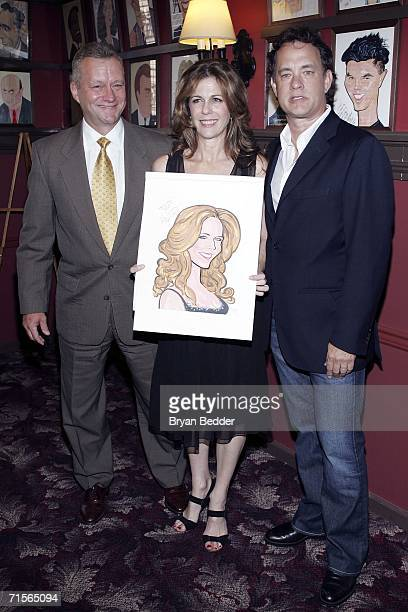 Owner of Sardi's restaurant Max Klimauicius actress Rita Wilson and actor Tom Hanks pose with a caricature made in her honor for her Broadway debut...