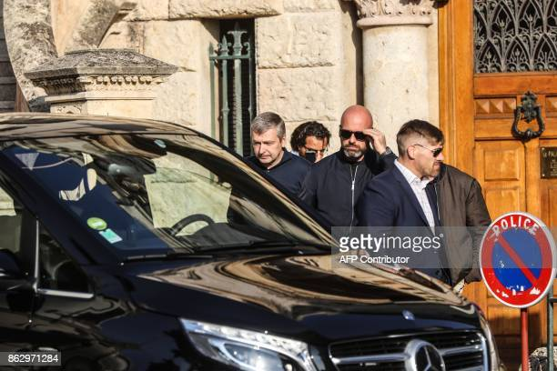 Owner of the AS Monaco football club Russian millionaire Dimitri Rybolovlev leaves after appearing at the Monaco courthouse on October 19 and being...