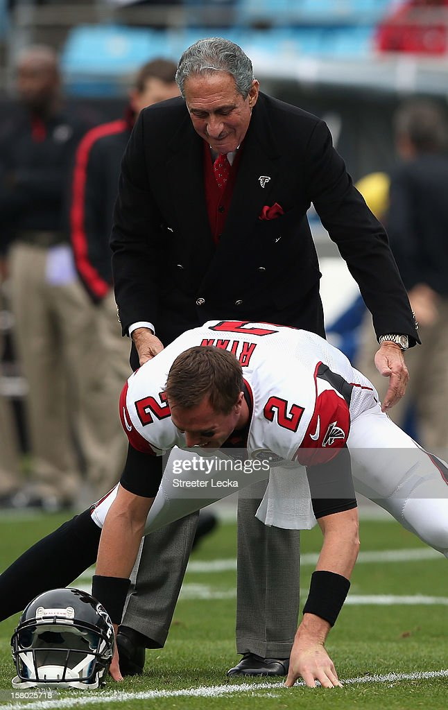 Owner of the Atlanta Falcons, Arthur Blank, talks to quarterback Matt Ryan #2 of the Atlanta Falcons before their game against the Carolina Panthers at Bank of America Stadium on December 9, 2012 in Charlotte, North Carolina.