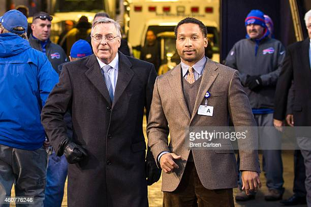 Owner of the Buffalo Bills Terry Pegula and Buffalo Bills General Manager Doug Whaley wait to greet the team as they come off the field after beating...