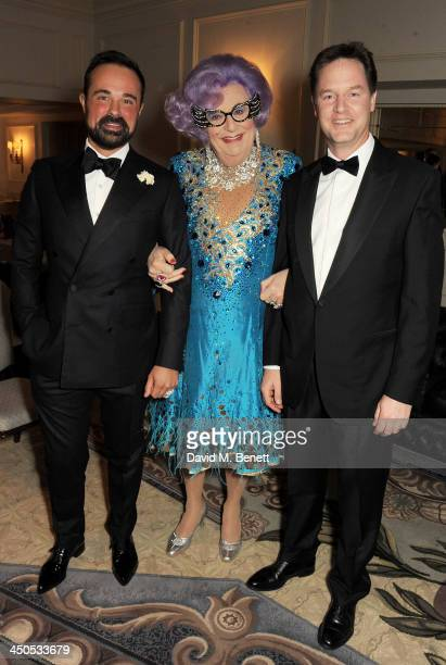 Owner of the London Evening Standard Evgeny Lebedev Dame Edna Everage and Deputy Prime Minister Nick Clegg attend a drinks reception at the 59th...
