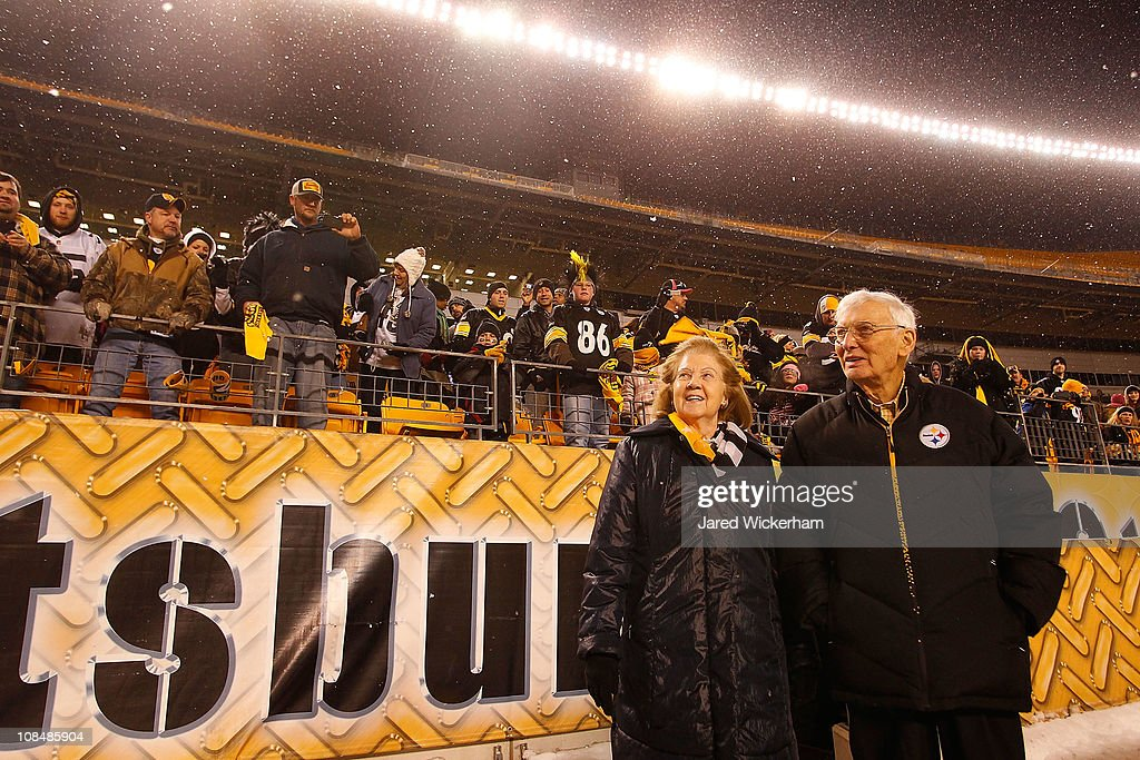 Owner of the Pittsburgh Steelers <a gi-track='captionPersonalityLinkClicked' href=/galleries/search?phrase=Dan+Rooney&family=editorial&specificpeople=725695 ng-click='$event.stopPropagation()'>Dan Rooney</a> (R) and his wife walk to the stage during the Super Bowl XLV Pep Rally on January 28, 2011 at Heinz Field in Pittsburgh, Pennsylvania.