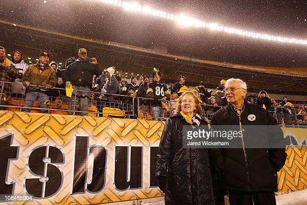 Owner of the Pittsburgh Steelers Dan Rooney and his wife walk to the stage during the Super Bowl XLV Pep Rally on January 28 2011 at Heinz Field in...
