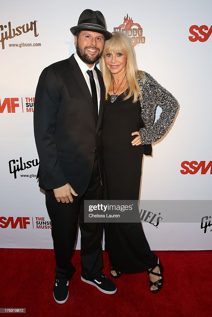 Owner of The Roxy Nic Adler (L) and actress Britt Ekland arrive at the 6th annual Sunset Strip Music Festival launch party honoring Joan Jett at House of Blues Sunset Strip on August 1, 2013 in West Hollywood, California.