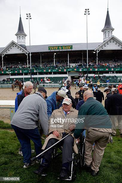 """Owner Ogden """"Dinny"""" Phipps is helped into the Winners circle after winning the 139th running of the Kentucky Derby with his horse Orb at Churchill..."""