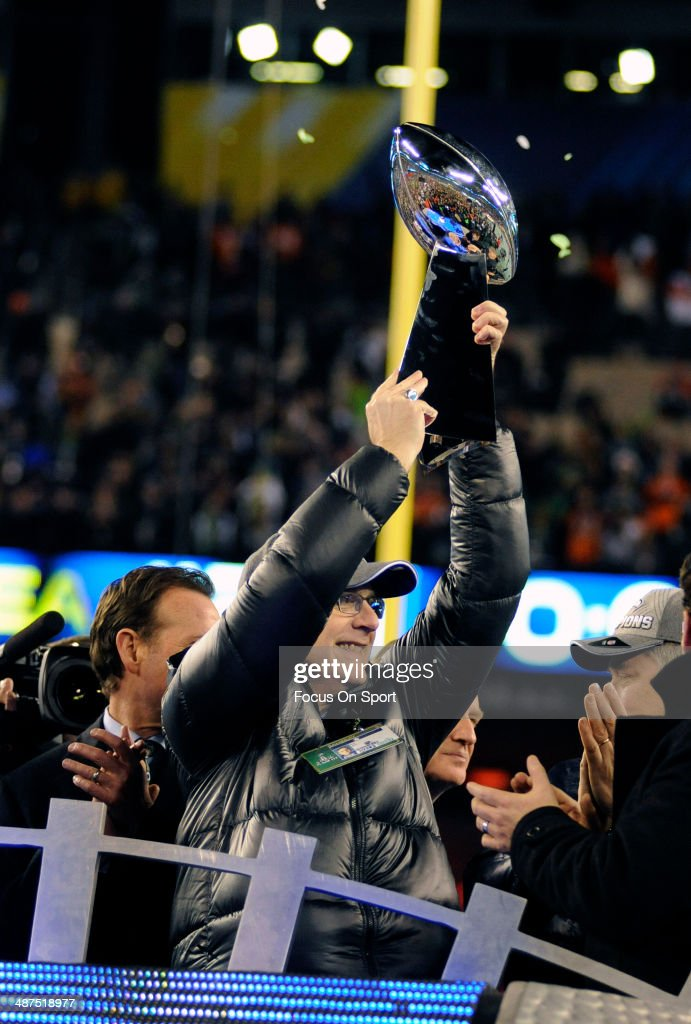Owner Paul Allen of the Seattle Seahawks hold up the Lombardi Trophy as the Super Bowl Champions after they defeated the Denver Broncos in Super Bowl XLVIII on February 2, 2014 at MetLife Stadium in East Rutherford, New Jersey. The Seahawks won the game 43-8.