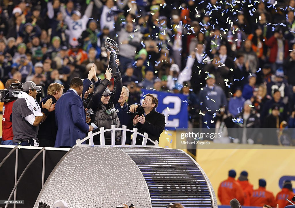 Owner Paul Allen of the Seattle Seahawks holds the Super Bowl Trophy over his head during the trophy ceremony following Super Bowl XLVIII against the Denver Broncos at MetLife Stadium on February 2, 2014 in East Rutherford, New Jersey.