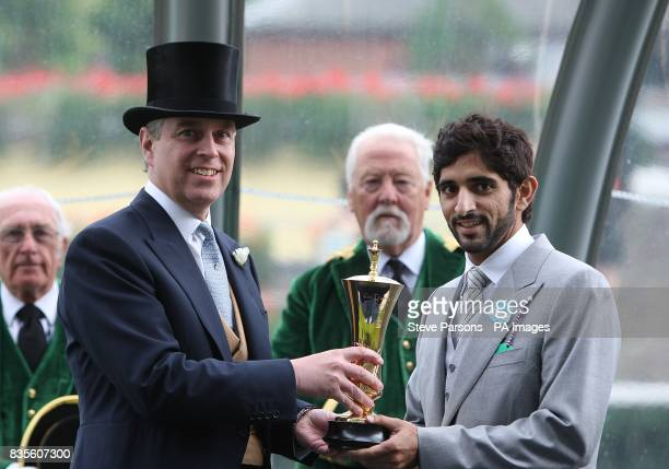 Owner Prince Sheikh Hamdan Bin Mohammed Al Maktoum with Prince Andrew after his horse Holberg wins the Queen's Vase at Ascot Racecourse Berkshire