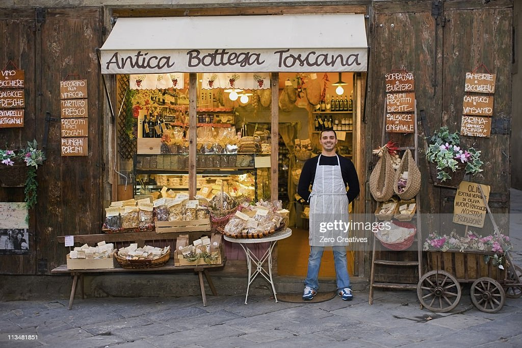 Owner standing in front of deli : Stock Photo